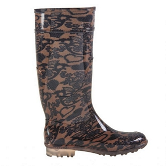 Womens knee-high rain boots with printed stocking-like effect and transparent tractor sole